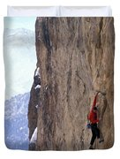 Man In A Red Shirt Lead Climbing Duvet Cover by Corey Rich