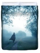 Man In Top Hat And Cape On Foggy Dirt Road Duvet Cover