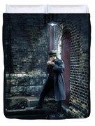 Man In Trenchcoat Lighting A Cigarette Duvet Cover
