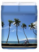 Man Riding Bicycle Beside Palm Trees Duvet Cover