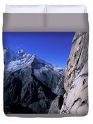 Man Rock Climbing Duvet Cover
