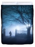 Man Standing In Foggy Gateway At Night Duvet Cover