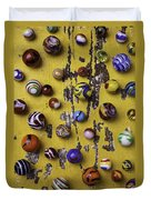 Marbles On Yellow Wooden Table Duvet Cover