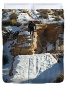 Mountain Biker Jumping With Snowy Duvet Cover