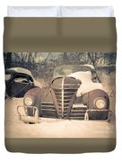 Old Plymouth Classic Car In The Snow Duvet Cover