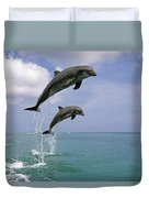 Pair Of Bottle Nose Dolphins Jumping Duvet Cover