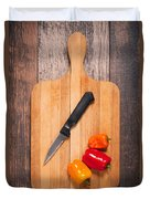 Peppers And Knife On Cutting Board Duvet Cover