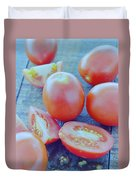 Plum Tomatoes On A Wooden Board Duvet Cover by Romulo Yanes