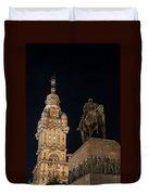 Public Statue And Skyscraper At Night Duvet Cover