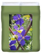Purple Clematis Clinging On A Fence Duvet Cover