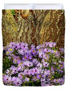 Purple Flowers At Base Of Tree Duvet Cover