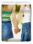 Rear View Of Girls Holding Hands Duvet Cover by Design Pics RF