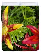 Red And Yellow Lilly Flowers In The Garden Duvet Cover