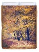 Riding A Bike In Autumn Duvet Cover