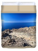 rocky coast in San Pietro island Duvet Cover