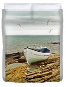 Row Boat On Rocky Shore Duvet Cover