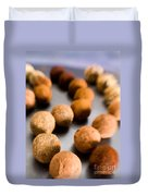Rows Of Chocolate Truffles On Silver Duvet Cover