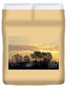 Sandhill Cranes Flying At Sunset Duvet Cover