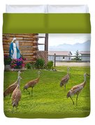 Sandhill Cranes On The Lawn By The Statue Of Mary In Homer-alaska Duvet Cover