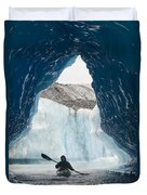 Sea Kayaker Paddles Through An Ice Cave Duvet Cover