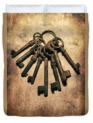 Set Of Old Rusty Keys On The Metal Surface Duvet Cover