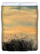 Silhouette Of Grass And Weeds Against The Color Of The Setting Sun Duvet Cover
