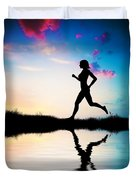 Silhouette Of Woman Running At Sunset Duvet Cover