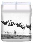 Six Men Doing Beach Flips Duvet Cover