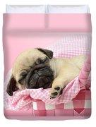 Sleeping Pug In Pink Basket Duvet Cover by Greg Cuddiford