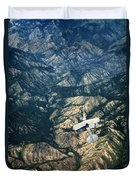 Small Plane Flying Over Mountains Duvet Cover