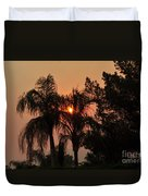 Smoke Covered Sky Sunset Thru The Palm Trees Duvet Cover