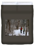Snowshoeing In The Park Duvet Cover