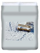 Snowy Foot Prints Around Snow Covered Park Bench Duvet Cover
