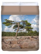 Solitary Tree Amidst Field Of Boulders Duvet Cover