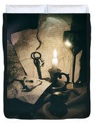 Still Life With Bones Rusty Key Wine Glass Lit Candle And Papers Duvet Cover