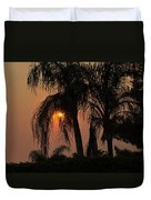Sun Setting Behind The Queen Palm Covered In Smoke Duvet Cover