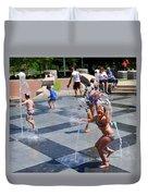 Joyful Young Girl Playing In Fountain Duvet Cover