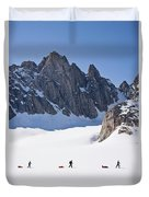 Three People Ski-tour On Karale Glacier Duvet Cover