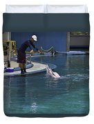 Trainer Feeding Duo Of Dolphins At The Underwater World In Sentosa Duvet Cover