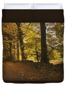 Tree Lined Road Covered With Fallen Duvet Cover by John Short