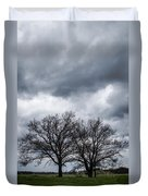 Two Trees Beneath A Dark Cloudy Sky Duvet Cover