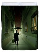 Victorian Man With Top Hat Carrying A Suitcase And Umbrella Walking In The Narrow Street At Night Duvet Cover