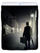 Victorian Man With Top Hat Carrying A Suitcase Walking In The Old Town At Night Duvet Cover