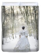 Victorian Woman Running Through A Winter Woodland With Fallen Sn Duvet Cover