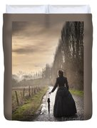 Victorian Woman Walking On A Cobbled Avenue At Sunset Duvet Cover