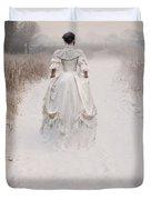 Victorian Woman Walking Through A Winter Meadow Duvet Cover