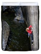 Woman Climbing Above A River Duvet Cover