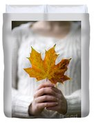 Woman Holding An Autumn Leaf Duvet Cover