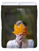 Woman Holding An Autumnal Leaf Duvet Cover