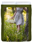 Woman Picking Flowers In A Wild Flower Meadow Duvet Cover